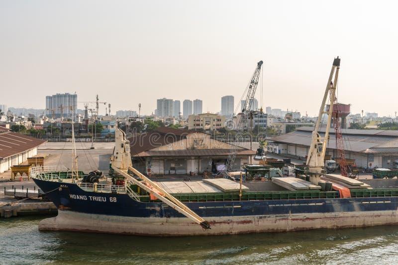 Hoang Trieu 68 ship handled at port on Song Sai Gon River, Ho Chi Minh City, Vietnam stock photo