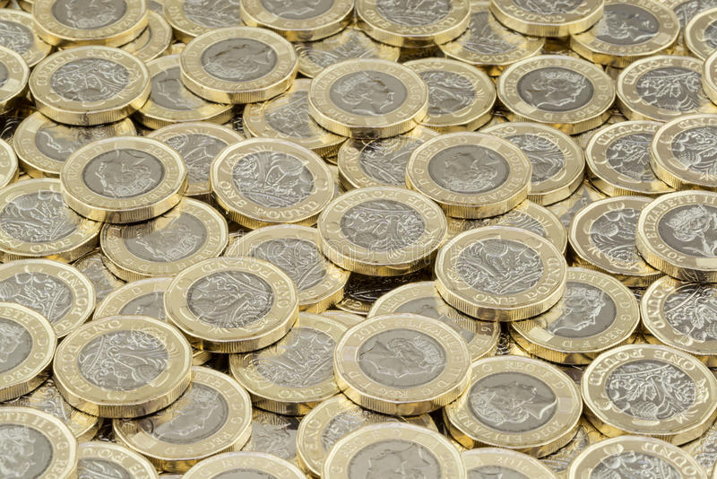 Hoard of money. Scattered pile of British pound coins. Hoard of money. Lots of coins scattered in a large pile. New British pound coins introduced in 2017 stock image