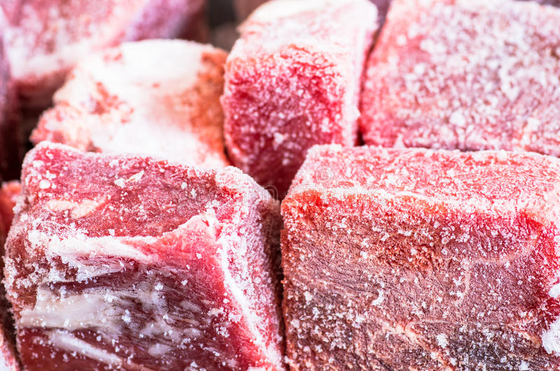 Hoarfrost on frozen pieces of meat royalty free stock photo