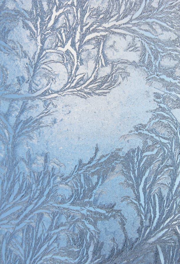 Window frost pattern on glass. Feathery frost pattern - ice flowers on window glass stock photos