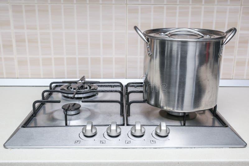 Hob cooker pot pan. Stainless steel cooking pot pan cooker hob stock photo