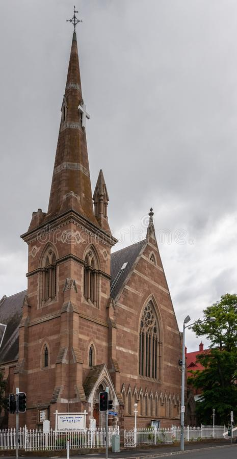 Hobart, Tasmania, Australia - December 14, 2009: Closeup of the brown stone Christian Science Church including spire downtown. Under gray cloudy sky. Street royalty free stock images