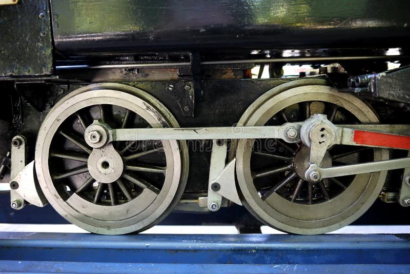Hobby: model steam train engine wheels. Working scale model steam train engine made by railway enthusiast - wheel detail royalty free stock image