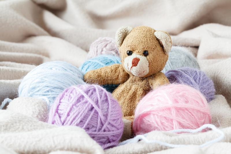 Hobby needlework concept. Handmade felt toy with colored wool cl. Ew royalty free stock images