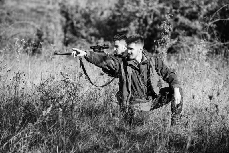 Hobby for real men concept. Hunters with rifles in nature environment. Hunter friend enjoy leisure in field. Hunters stock photos