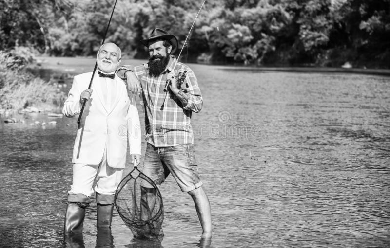 Hobby and recreation. Fisherman in formal suit. Successful catch. Friends fishing. Elegant bearded man and brutal royalty free stock images