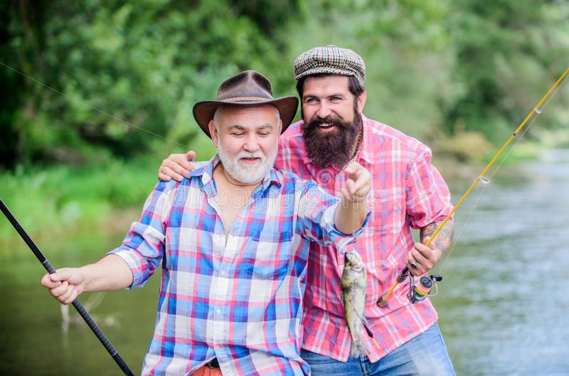 Hobby unites. hunting tourism. father and son fishing. Big game fishing. friendship. two happy fisherman with fishing royalty free stock photo