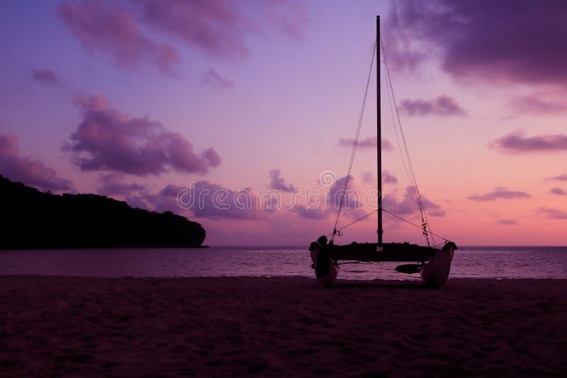 Hobie cat or catamaran on the beach at beautiful sunrise early morning royalty free stock photos