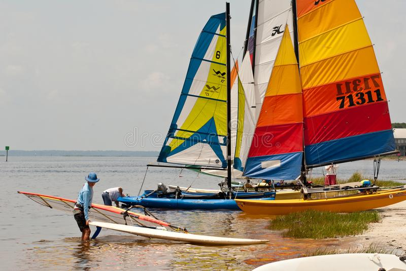 Hobie Cats on Florida`s Gulf Coast. Hobie Cats being prepared for launch on Florida`s Gulf Coast stock photo