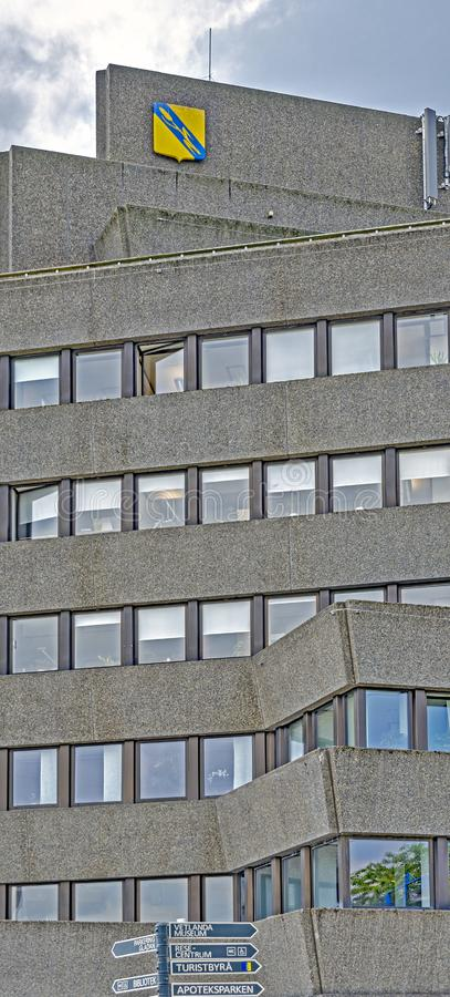 Concrete high-rise building. VETLANDA, SWEDEN - JUNE 4, 2019: high-rise building of municipal authority with facade made by washed concrete slabs stock photos