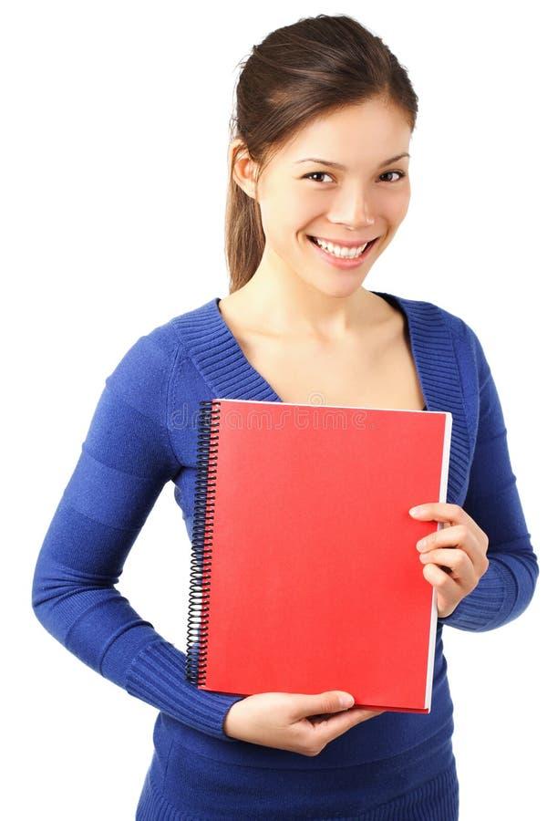 Hochschulmädchen mit Notizbuch lizenzfreie stockbilder