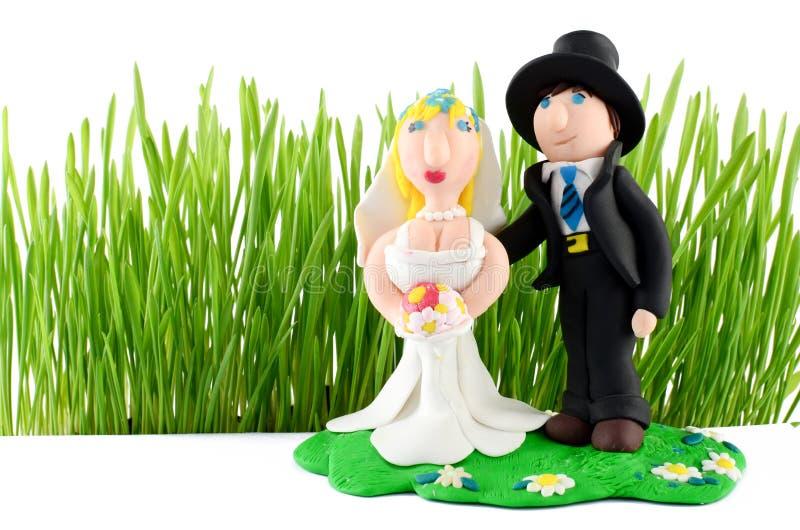 Hochzeitsfigürchen auf Weiß stock abbildung