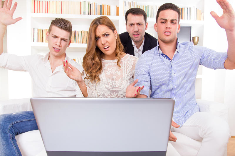 Download Hocked Casual Group Of Friends Sitting On Couch Looking At Lapto Stock Image - Image of presentation, friends: 39500571