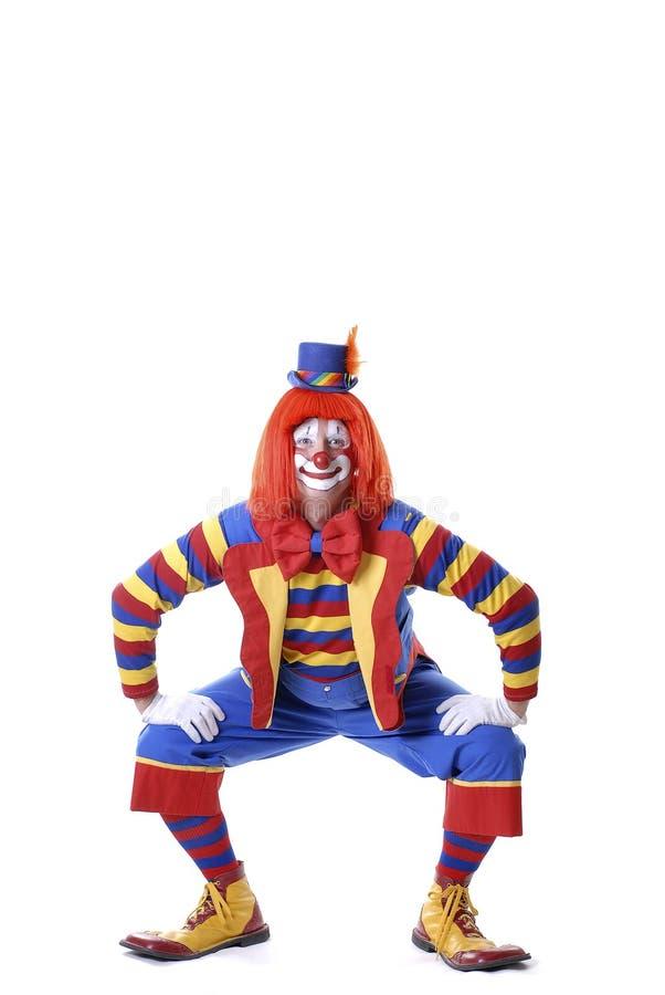 Hockender Zirkus-Clown stockbild