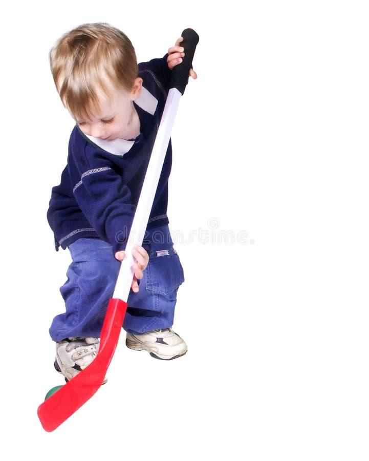 Hockey. Toddler boy playing hockey