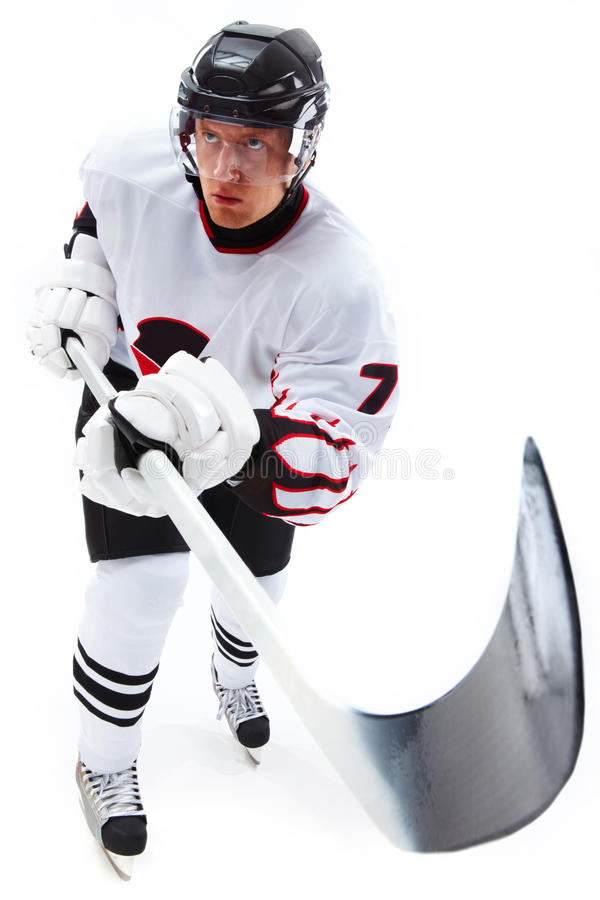 Hockey. Image of ice-hockey player holding stick and standing ice royalty free stock images