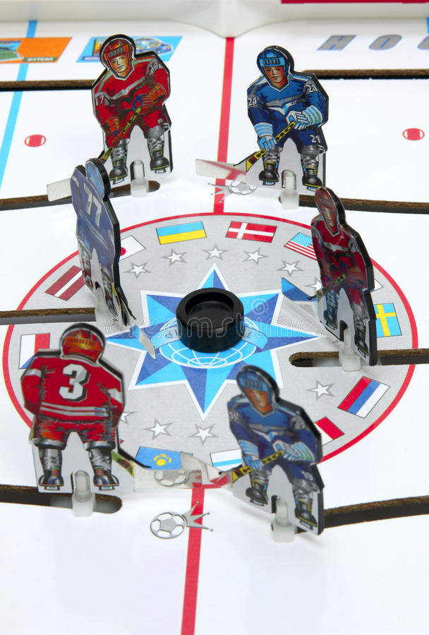 Hockey. Players on the ice field background. Board game royalty free stock image