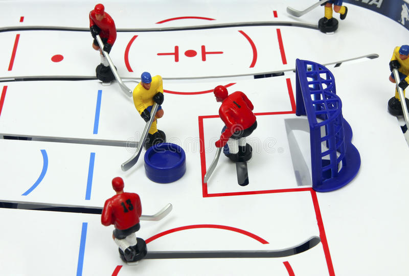 Hockey. Players on the ice field background. Board game royalty free stock images