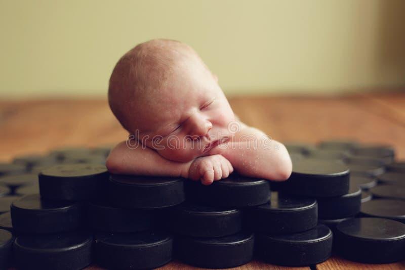 Hockey Baby. Newborn baby is a future hockey star stock photography
