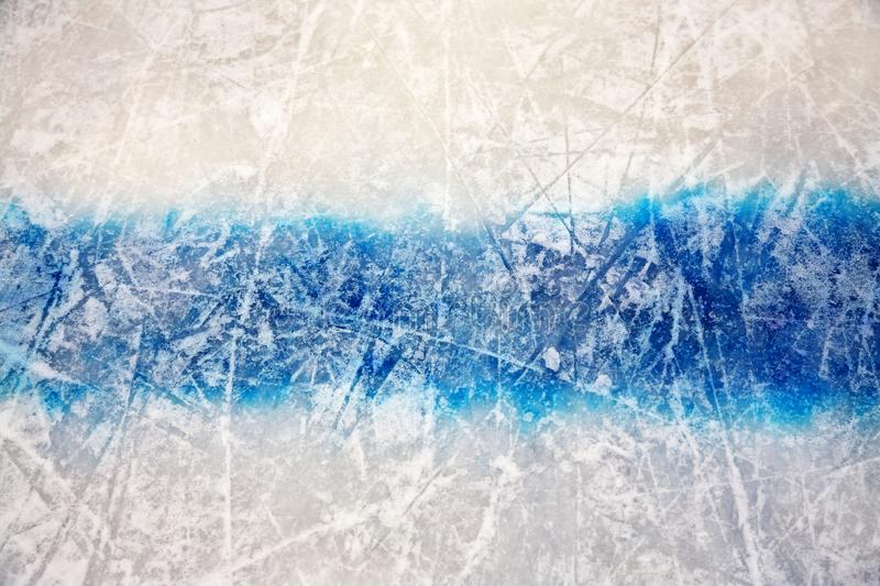 Hockey blue line on ice skating rink. sport background. Hockey blue line on ice skating rink. winter sport background royalty free stock images