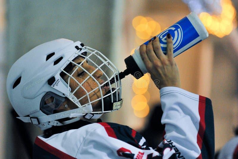 Hockey för kvinna` s arkivbild