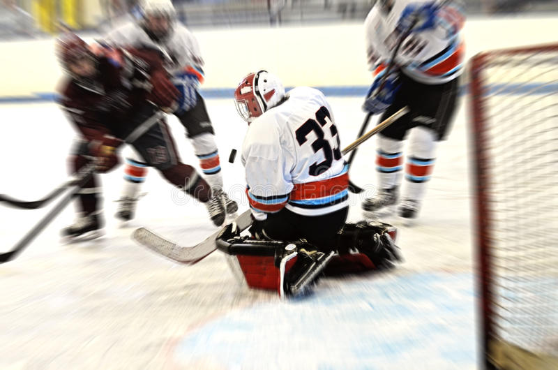 Hockey goalie action blur. An action blur of a teen/young adult hockey goalie blocking a shot royalty free stock image