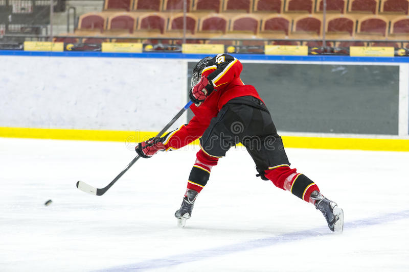 Hockey. Ice Hockey - Player makes a slap shot royalty free stock photos
