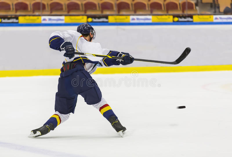 Hockey. Ice Hockey - Player makes a slapshot royalty free stock photos