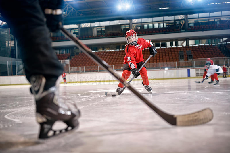 Hockey match at rink player in action. Kicking on goal stock photography