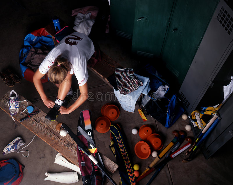 Hockey Player. Female Hockey player getting ready in change room