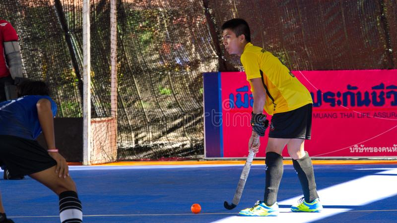 Hockey player in action during the Thailand National Games, Chiang Rai Games. Chiang Rai, Thailand – November 18, 2018 : Hockey player in action during stock photo