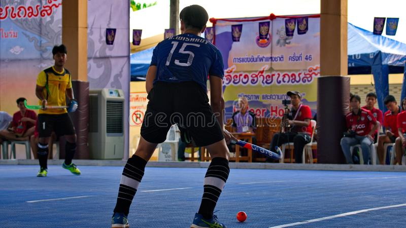 Hockey player in action during the Thailand National Games, Chiang Rai Games. Chiang Rai, Thailand – November 18, 2018 : Hockey player in action during royalty free stock photos