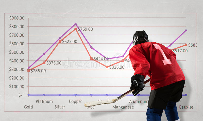 Hockey player and dynamics graph. Mixed media. Hockey game player and infographs at background. Mixed media stock image