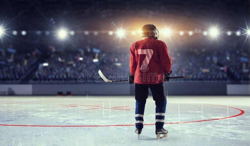 Hockey player on ice . Mixed media royalty free stock photography