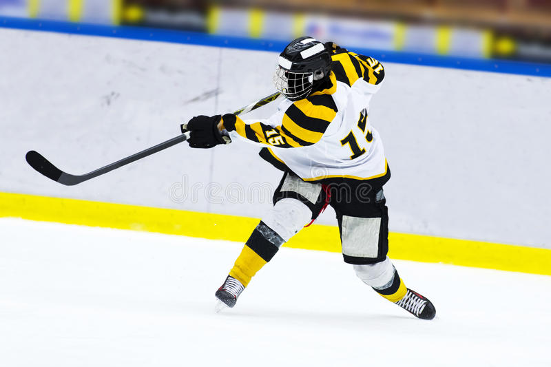 Hockey player - Slap shot. Ice hockey player - Slap shot royalty free stock photography