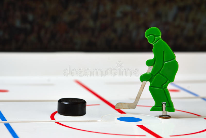 Hockey player. Toy hockey player in a center of field stock images