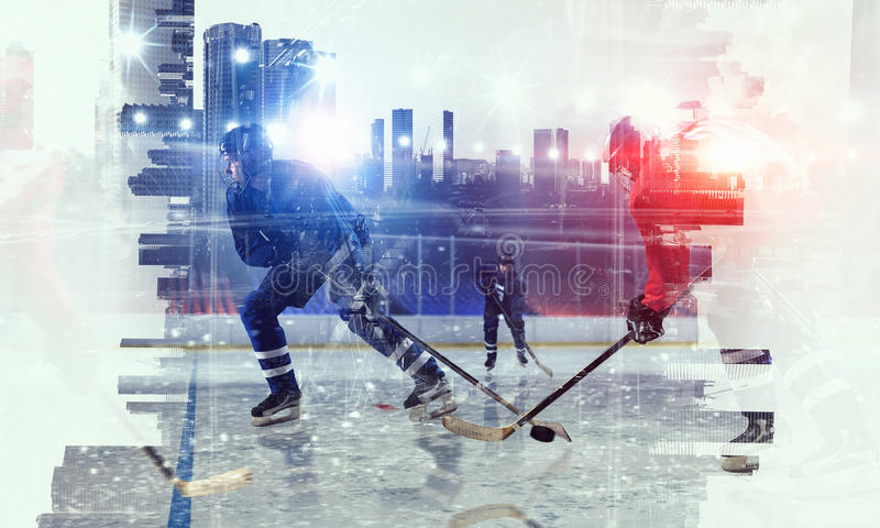 Hockey players on ice. Double exposure image of hockey players and modern city stock photography