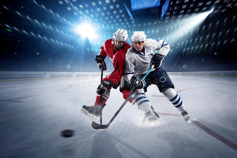 Hockey players shoots the puck and attacks stock photo