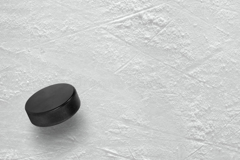 Hockey puck on ice. Hockey puck on the ice arena. Texture, background stock images