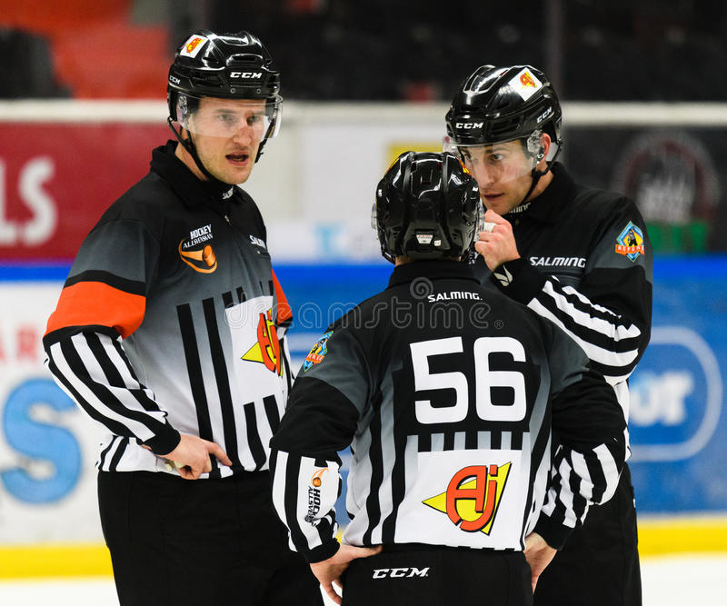 Hockey referees discussing something in the game in the Ice hockey match in hockeyallsvenskan between SSK and MODO. Sodertalje, Sweden - January 15, 2017: hockey stock images