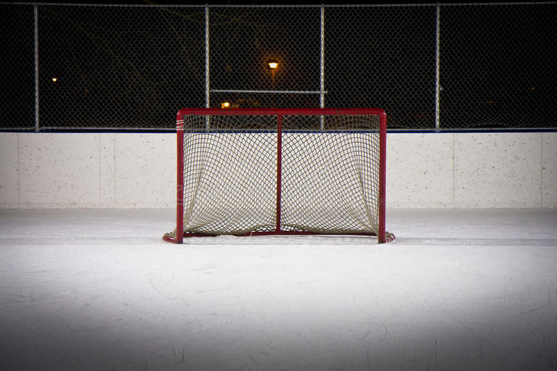 Hockey Rink Net. Photo of a hockey net on an outdoor rink at night