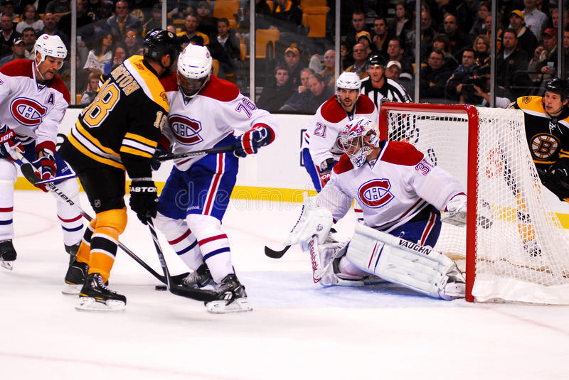 Hockey's Oldest Rivalry. Montreal defence gets in front of goaltender Carey Price as the puck comes towards him. Boston/Montreal is one of professional hockey's stock images
