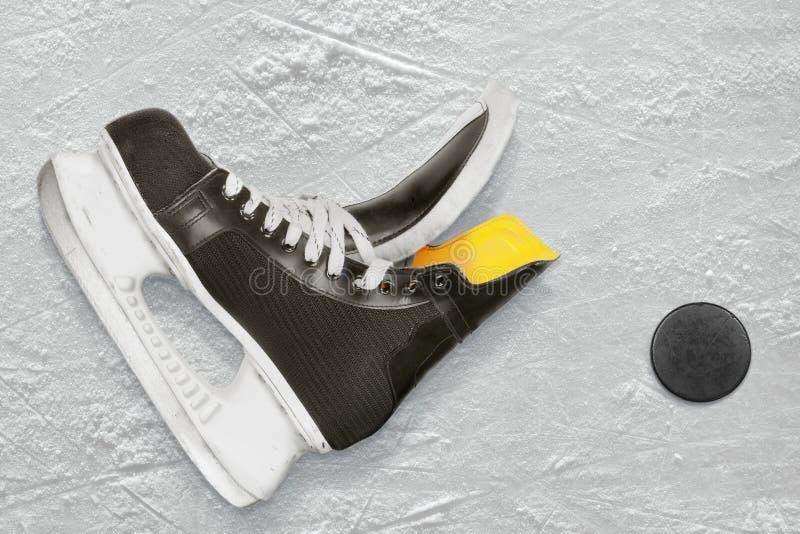 Hockey Skates And Puck Royalty Free Stock Image