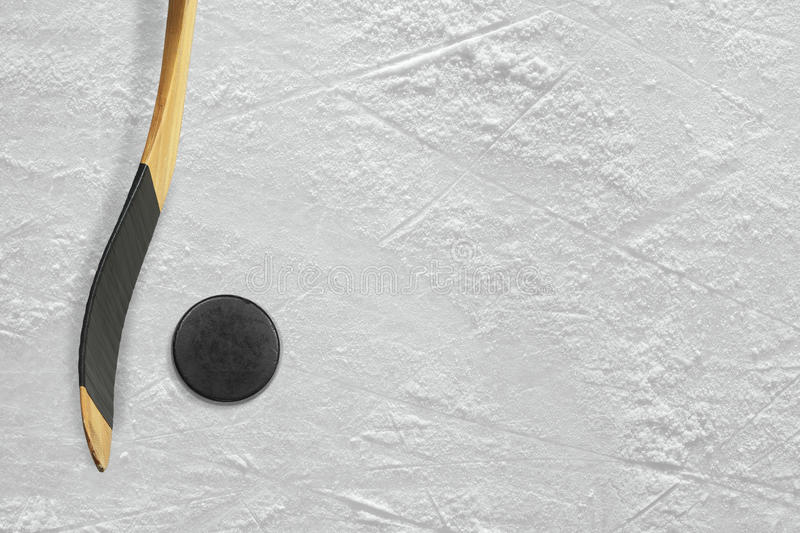 Hockey stick and puck on the ice stock images