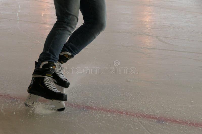 Hockey stop, breaking on ice stock image