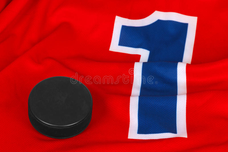 Hockey sweater and washer royalty free stock image
