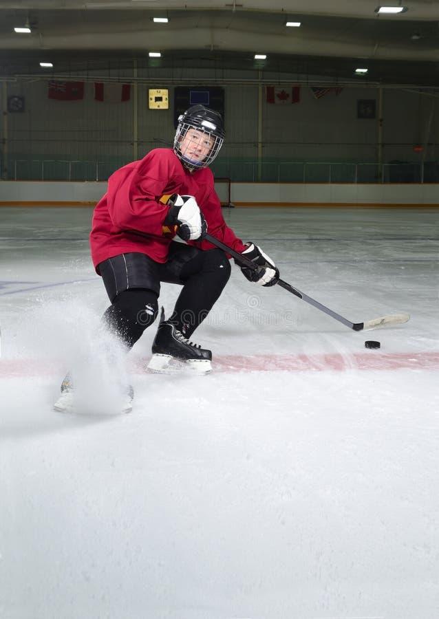 Hockeyspelarebeslutsamhet arkivfoto