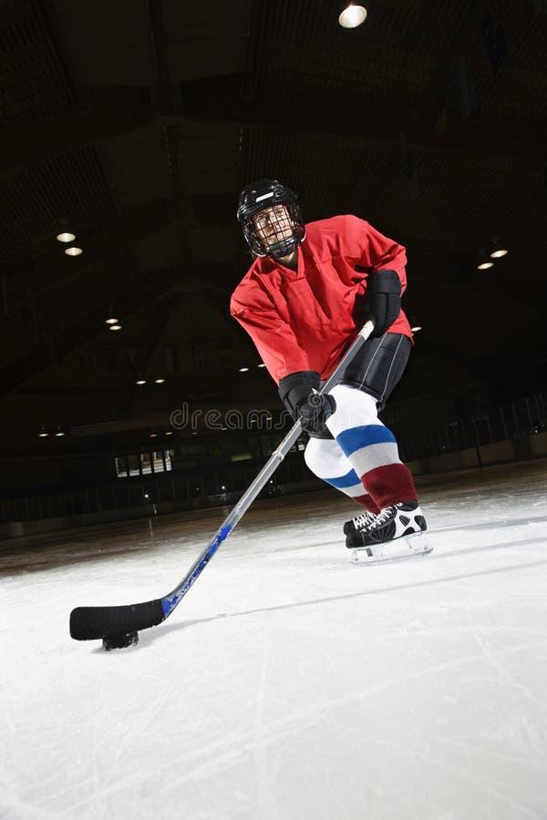 hockeyspelarekvinna royaltyfri foto