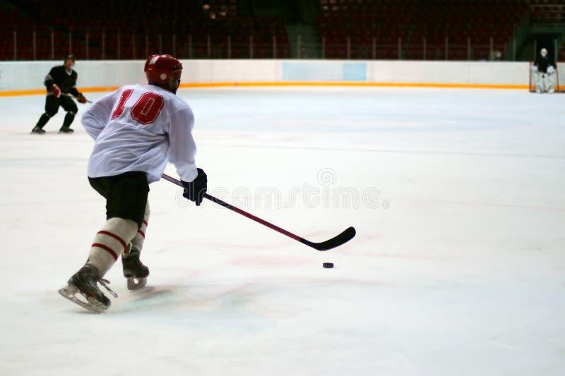 Hockeyspeler stock afbeelding