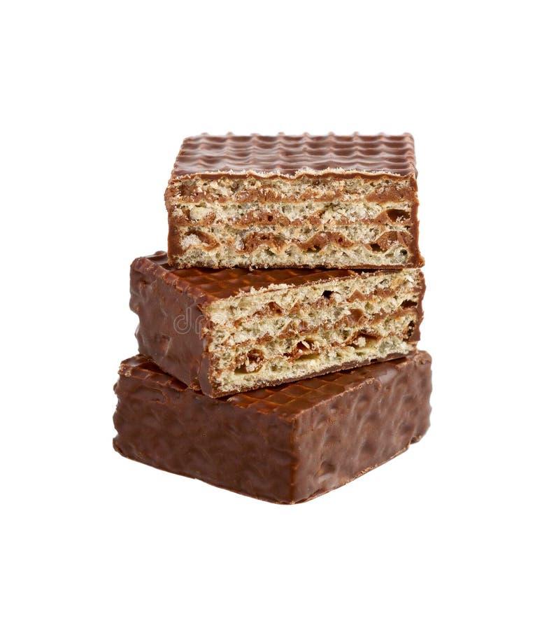 Hocolate γκοφρέτες Ð ¡ Εύγευστος φραγμός σοκολάτας κομματιών η τομή σοκολάτας καραμελών ανασκόπησης απομόνωσε το λευκό στοκ φωτογραφίες